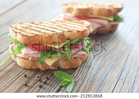 Grilled deli sandwiches with ham and cheese  - stock photo