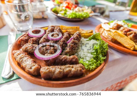 Grilled dish of minced meat on plate in restaurant traditional food of countries southeastern Europe