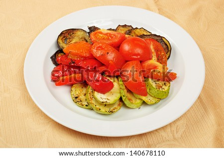 Grilled eggplant and tomatoes on the dish in restaurant - stock photo