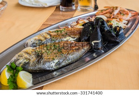 Grilled fish and seafood - stock photo