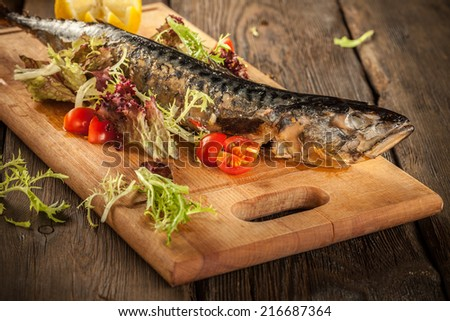 Grilled fish and vegetables - stock photo