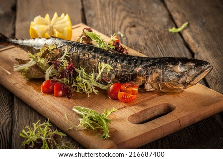 Grilled fish and vwgwtables - stock photo