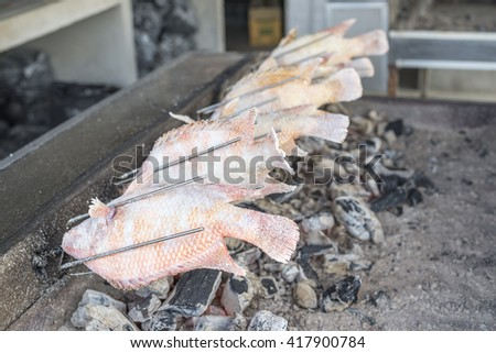 Grilled fish, delicious Asian food of Thailand. Nile tiapia fish or Oreochromis niloticus-mossambicus fish. - stock photo