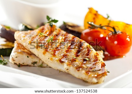 Grilled Fish Fillet with BBQ Vegetables - stock photo