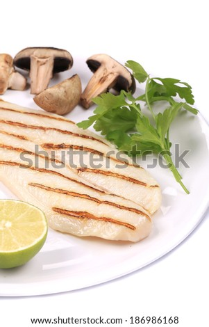 Grilled fish fillet with mushrooms. Isolated on a white background. - stock photo