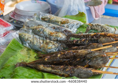 Grilled fish for sale at the Thai street food market - stock photo