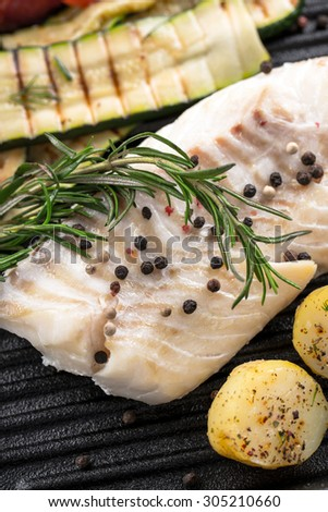 grilled fish on frying pan - stock photo