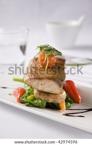 Grilled Fish served with salad peppers and tomato - stock photo