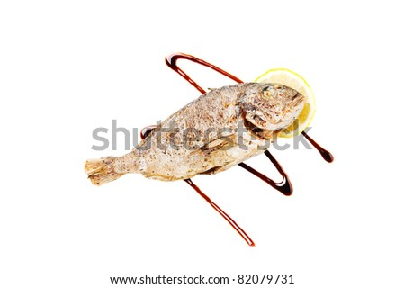 Grilled fish with lemon and soy sauce. Isolated on a white background. - stock photo