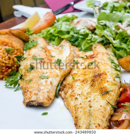 grilled fish with many vegetables