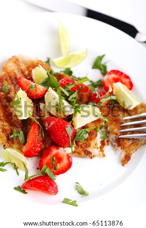 grilled fish with strawberry lime salsa on white plates