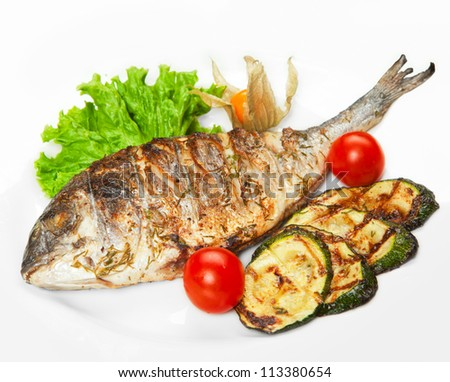 grilled fish with vegetables - stock photo