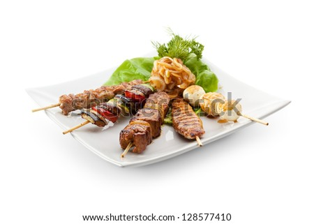 Grilled Foods Garnished with Parsley - stock photo