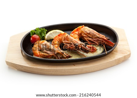 Grilled Foods - Grilled Shrimps with Sauce. Garnished with Lemon and Cherry Tomato - stock photo