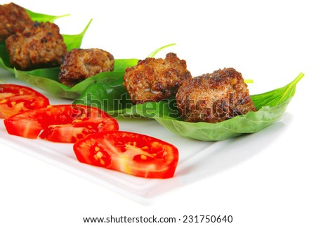 grilled french meat balls with tomatoes on white - stock photo