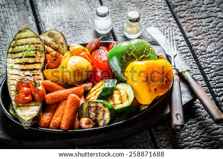 Grilled fresh vegetables on barbecue dish - stock photo