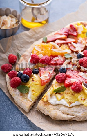 Grilled fruit pizza with cream cheese, honey and coconut best summer dessert - stock photo