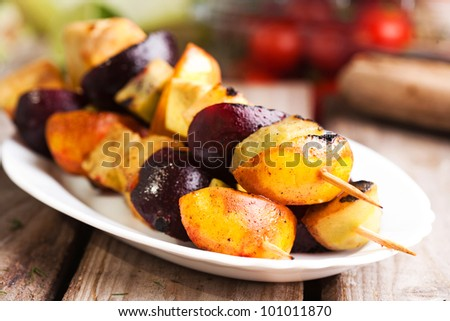 Grilled fruits on a stick - stock photo