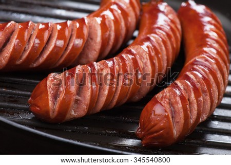 Grilled german sausages in grilling pan, close-up image - stock photo