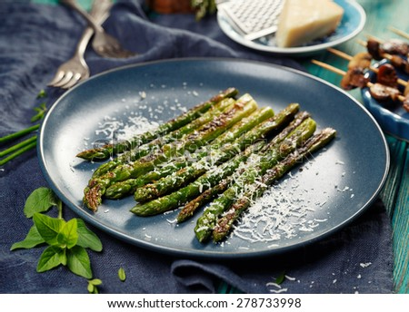 Grilled green asparagus with parmesan cheese - stock photo