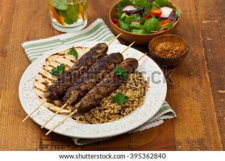 Grilled Ground Lamb Kebabs. Shallow dof. Selective focus. - stock photo