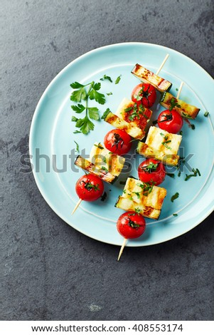 Grilled Halloumi, Cherry Tomato and Zucchini Skewers - stock photo