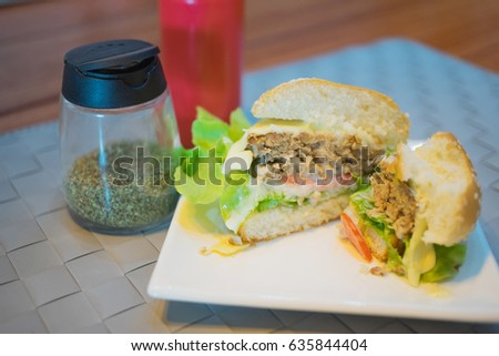 Grilled hamburger lettuce and tomato slice on the table
