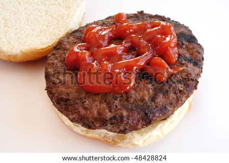 Grilled Hamburger with Catsup (Ketchup) on a Bun - stock photo