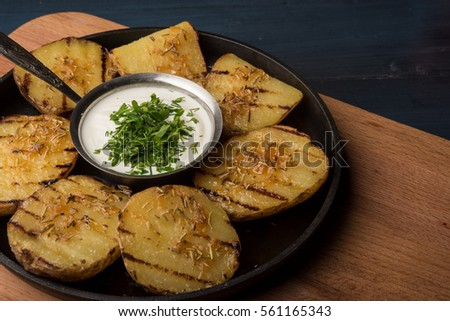 Grilled herb potatoes on a pan