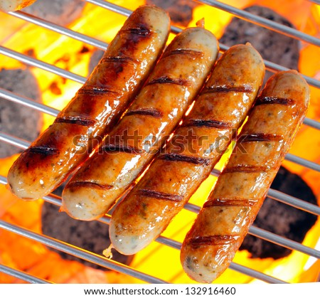 Grilled Italian pork sausage on a grilling pan - stock photo