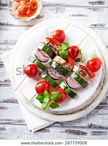 Grilled kebabs with vegetables and pork tenderloin - stock photo