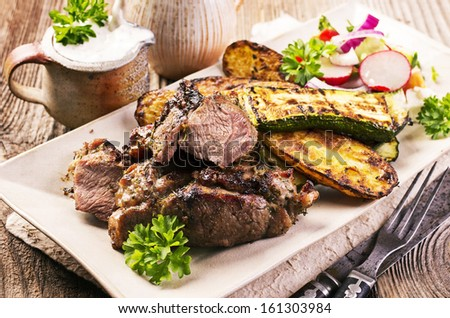 grilled lamb with vegetables - stock photo