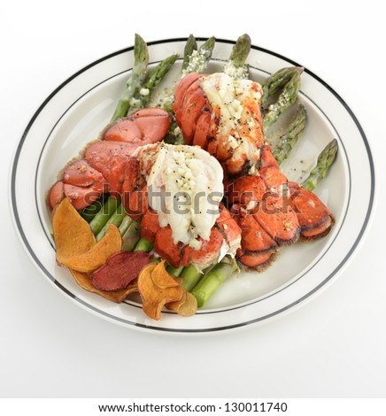 Grilled Lobster Tail Served With Asparagus - stock photo