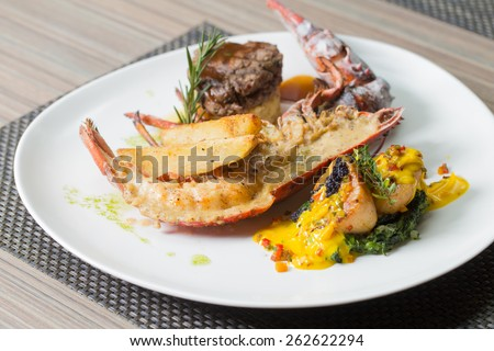 Grilled Lobster with Beef Tenderloin and Scallop - stock photo