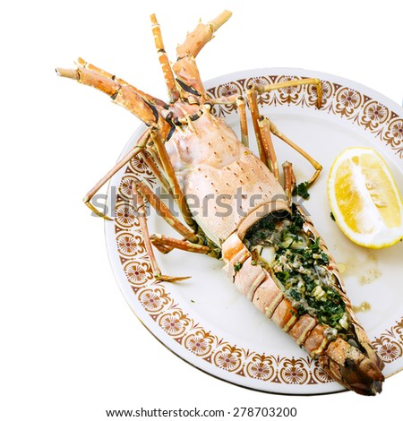 Grilled Lobster with garlic butter on dish - stock photo