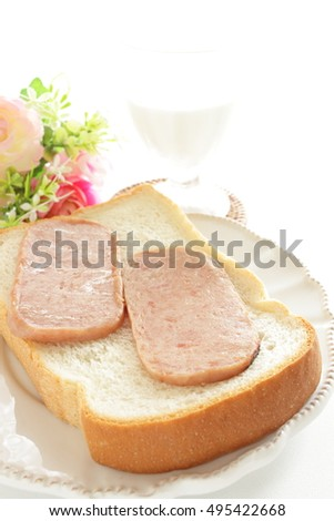 grilled Luncheon meat on bread with milk