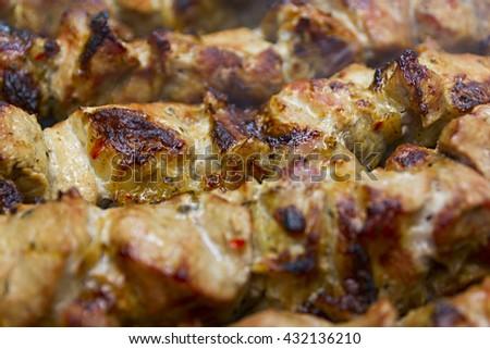 Grilled Marinated Caucasus Barbecue Meat Shashlik (Shish Kebab) Pork Meat Grilling On Metal Skewer Close Up - stock photo