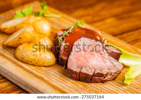 Grilled Meat and potatoes - stock photo