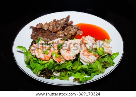 Grilled meat and shrimps with vegetables, barbecue grill food - stock photo