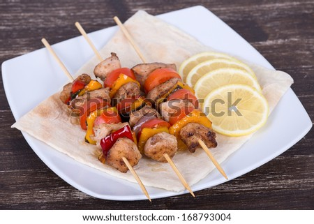 Grilled meat and vegetables on skewer  - stock photo