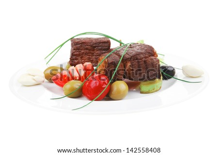 grilled meat : beef ( lamb ) garnished with tomatoes , green and black olives on white plate isolated over white background - stock photo