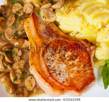 grilled meat fillet steak with Mushroom Sauce and mashed potato in a plate on wooden table - stock photo