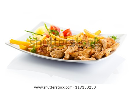 Grilled meat French fries and vegetables on white background - stock photo