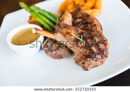 Grilled meat lamp steak - soft focus point - stock photo