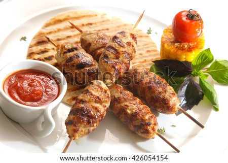 grilled meat on a stick with sauce - stock photo