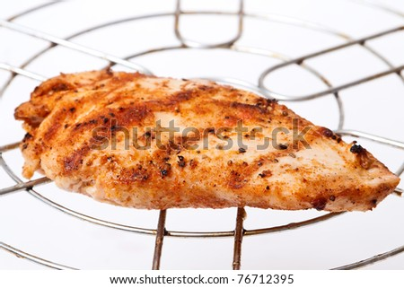 grilled  meat on grid on white background - stock photo