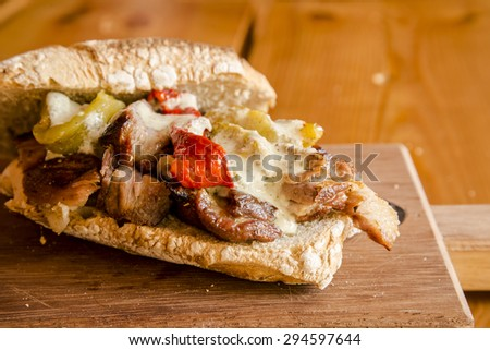 Grilled meat, peppers and rustic homemade bread sandwich