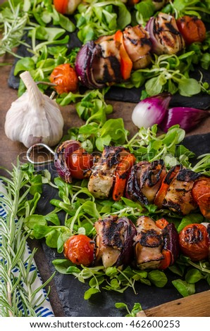 Grilled meat skewer with bacon and crunchy vegetables