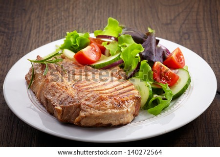 Grilled meat steak and fresh vegetables salad - stock photo