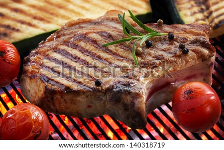Grilled meat steak and vegetables on grill